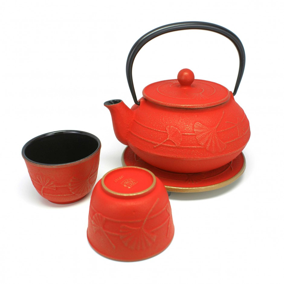 Japanese tea service in cast iron teapot cups underneath. IWACHU. gold/red Gingko