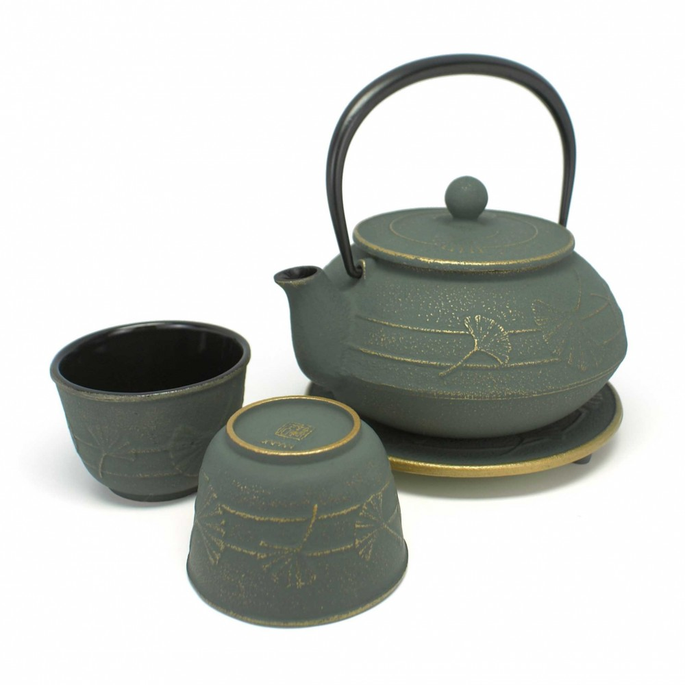 Japanese tea service in cast iron teapot cups underneath. IWACHU. Bronze Gingko